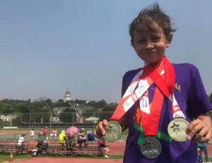 Dylan with medals